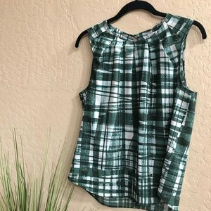 green sleeveless blouse • pleated neckline •